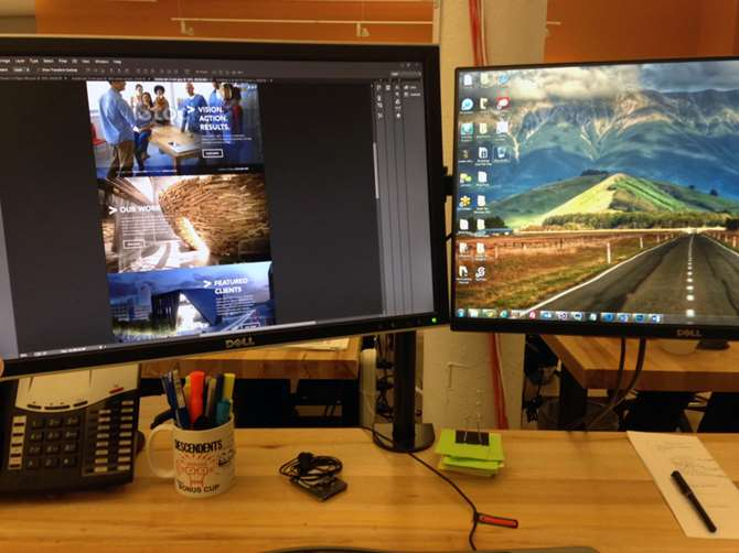 Image of Justin's workspace at Aztek. Current work on screen. Learn about Justin's essential web design tools.