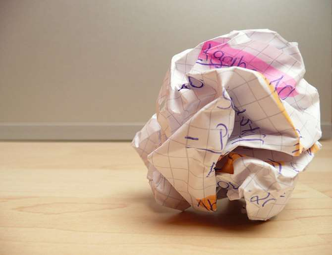 Image of crumpled paper on the floor. Stop writer's block by brainstorming topics for an editorial calendar. Learn how. Picture by photosteve101 is licensed under CC BY 2.0